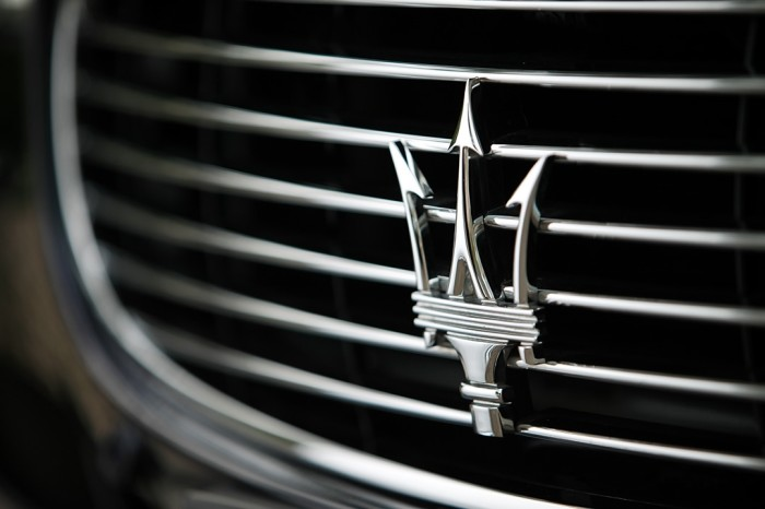 Maserati logotype, emblem, logo on the car
